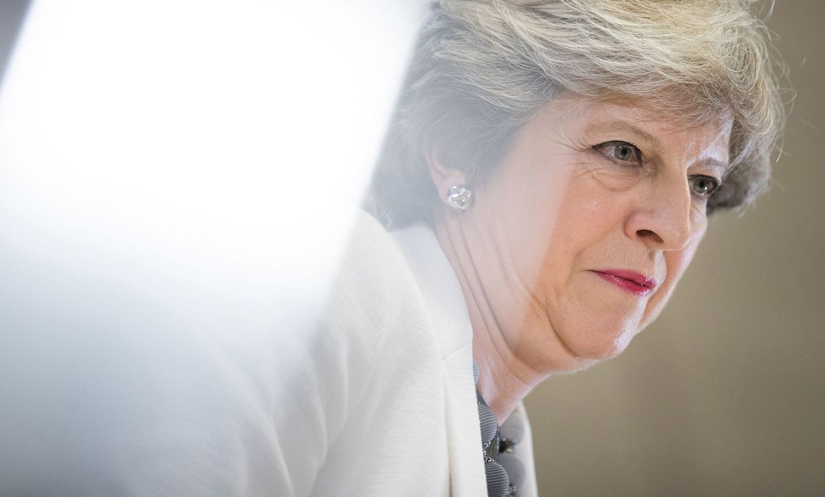 """U.K. Prime Minister Theresa May warned Russian President Vladimir Putin to curb his attempts to destabilize western democracy, telling him that Britain was ready to fight back, to defend not just itself but the rest of Europe as well. """"We know what you are doing."""""""
