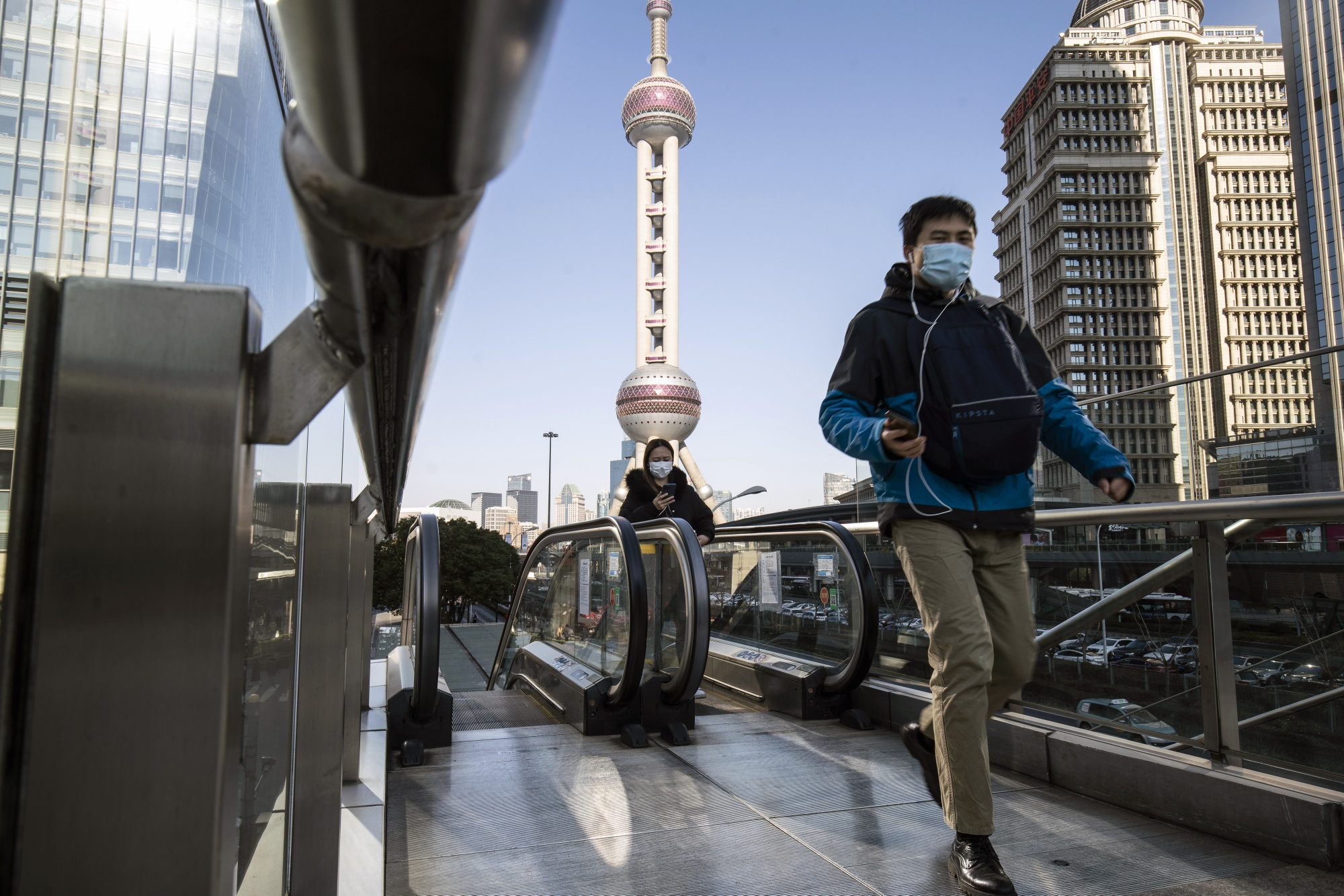 Commuters in Shanghai as China Stocks' Strong Start to New Year Falters Near Record High