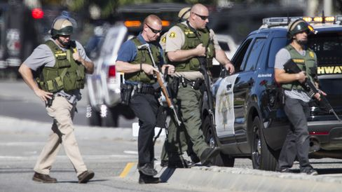 Police officers secure the scene where a mass shooting occurred at the Inland Regional Center in San Bernardino, California, on Dec. 2.