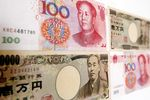 Chinese renminbi and Japanese yen bank notes.