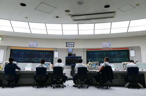 Tokyo Metro Co. employees observe traffic indication panels while working at the Tokyo Metro Integrated Control Center in Tokyo. Photographer: Noriko Hayashi/Bloomberg