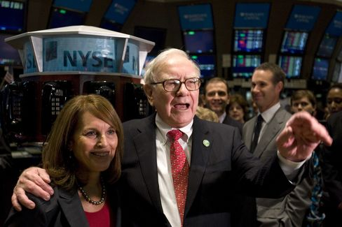 Warren Buffett and Cathy Baron Tamraz