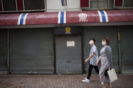Japan Prime Minister Suga Extends Virus Emergency to Sept. 30