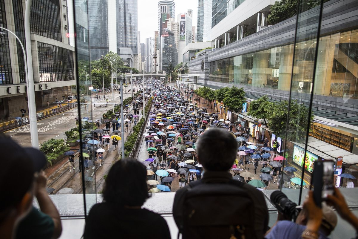 Hong Kong Resets Democracy Push With Peaceful Mass March in Rain