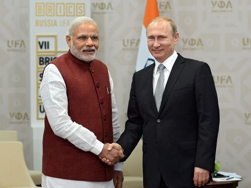 In this handout image, Vladimir Putin (R) meets Prime Minister of the Republic of India Narendra Modi in Ufa, Bashkortostan, Russia, on July 08, 2015.