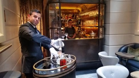 Agostino Perrone, director of mixology, makes a cocktail at the trolley in the Champagne Room.