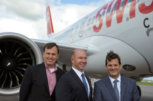 Alain Bellemare, centre, in front of a Bombardier CS100 in Quebec on June 29.