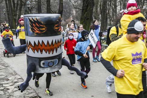 Protesters in costumes run in an anti-smog demonstration in Krakow and call for cleaner air.
