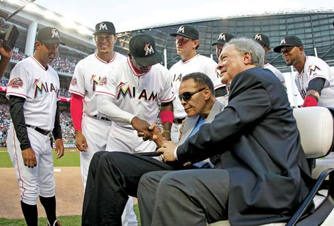 Muhammad Ali delivered the game ball on Opening Day, 2012