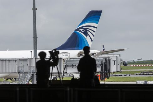 An EgyptAir Airlines plane stands beside a passenger walkway before departure from Charles de Gaulle airport, in Roissy, France, on May 19, 2016.