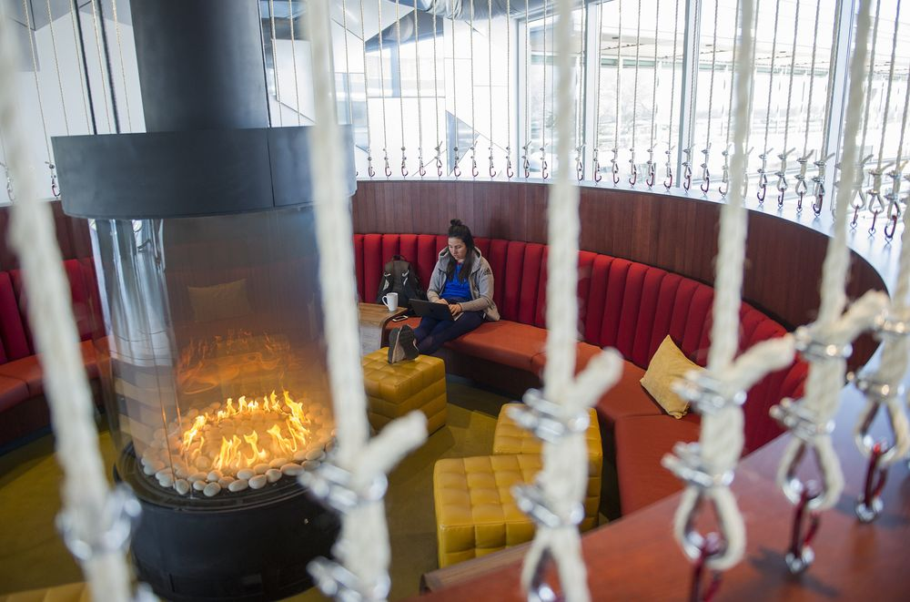 pics of google office. A Google Employee Takes A Seat By The Fireplace. Pics Of Google Office