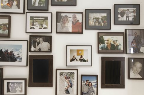 Framed photographs, many of which feature her late husband, interior decorator Eric Zeller, with whom she designed the apartment.