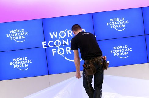 Davos Doom Loses to Merkel-Draghi as Euro Defies Roubini