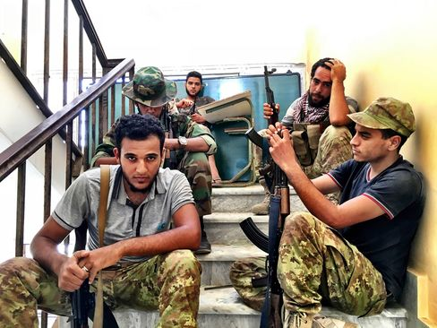 Fighters in a Misratan-led coalitionrest near Neighborhood 3 on Sept. 5, 2016. Forces under the unity government have been battling to oust Islamic State fighters in Sirte since May.