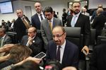Khalid Al-Falih speaks to reporters ahead of the 175th OPEC meeting in Vienna on Dec. 6.