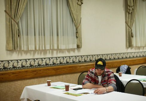 A farmer reads through the Annual Report at Ontario Ginseng Growers Association's 2016 AGM in Delhi, Ontario, about 150 km Southwest of Toronto.