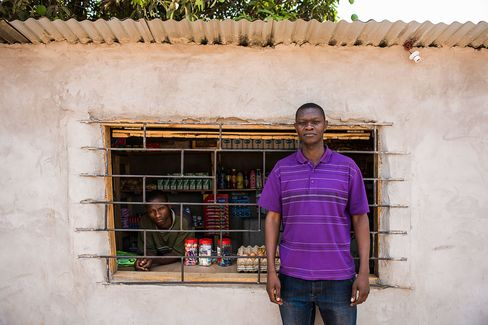Kelvin Sanga outside his food store near the Mopani Copper Mines Plc mine in Kitwe, Zambia.