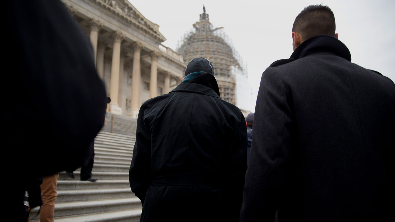 Representative Elijah Cummings, a Democrat from Maryland, center, walks towards the U.S. Capitol steps with congressional staff members during a protest in Washington on Dec. 11, 2014.