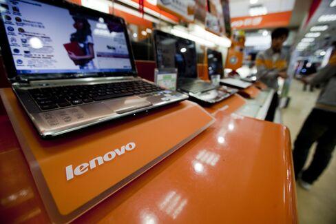 Lenovo Net Rises on Office Computer, Emerging Market Sales