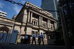 People enter the Bank of Japan (BOJ) headquarters in Tokyo, Japan.