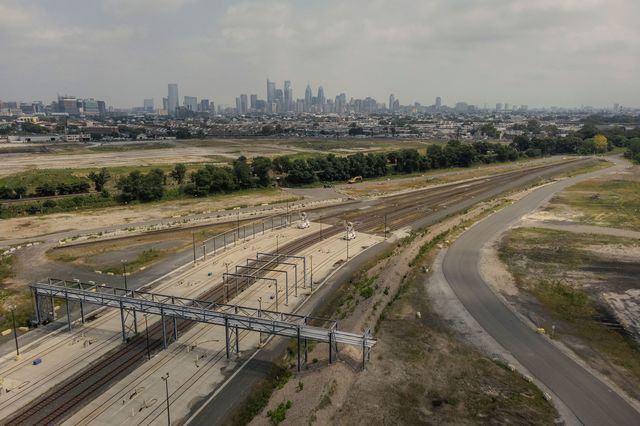 Train tracks run through a former offloading site, now mostly demolished, in the northern section of the 1,300 acre former Philadelphia Energy Solutions refinery location, now owned by Hilco Redevelopment Partners in Philadelphia, PA U.S., on Tuesday, Aug. 10, 2021.
