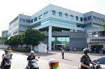 People enter the Hon Hai Precision Industry Co. headquartersin New Taipei City, Taiwan.
