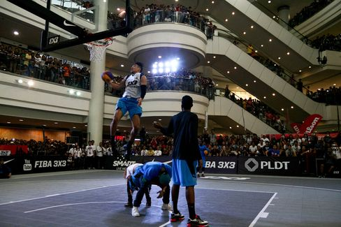 Francis Rey Guevarra of team Manila West jumps over two