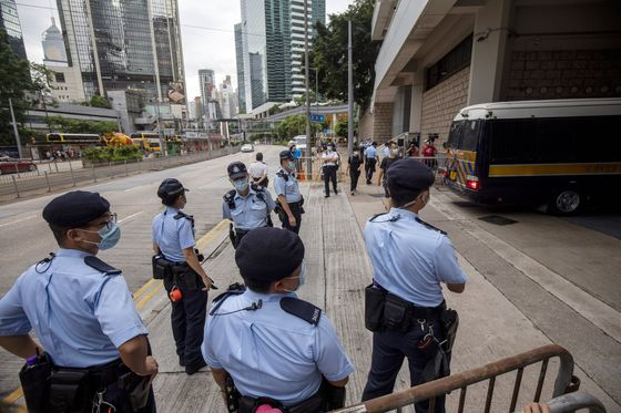 Hong Kong Police Arrest Apple Daily Writer in Ongoing Operation