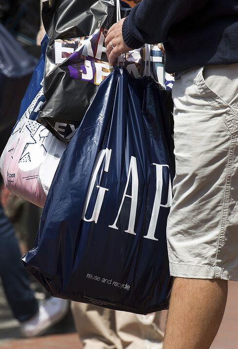 A Customer Carries A Gap Inc Shopping Bag