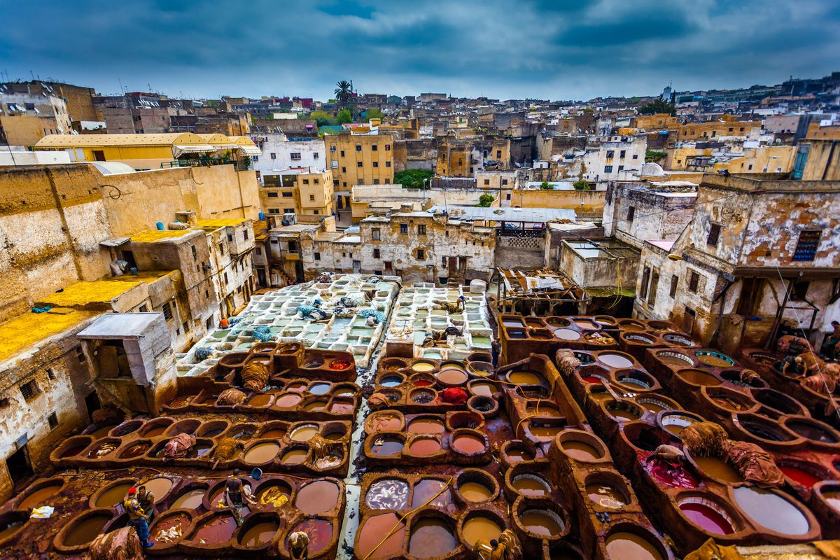 For a true olfactory experience of medieval Morocco, follow your nose to the Tanners' Quarter, where barefoot workers tread skins in dyeing pits. Photo from Bloomberg.com