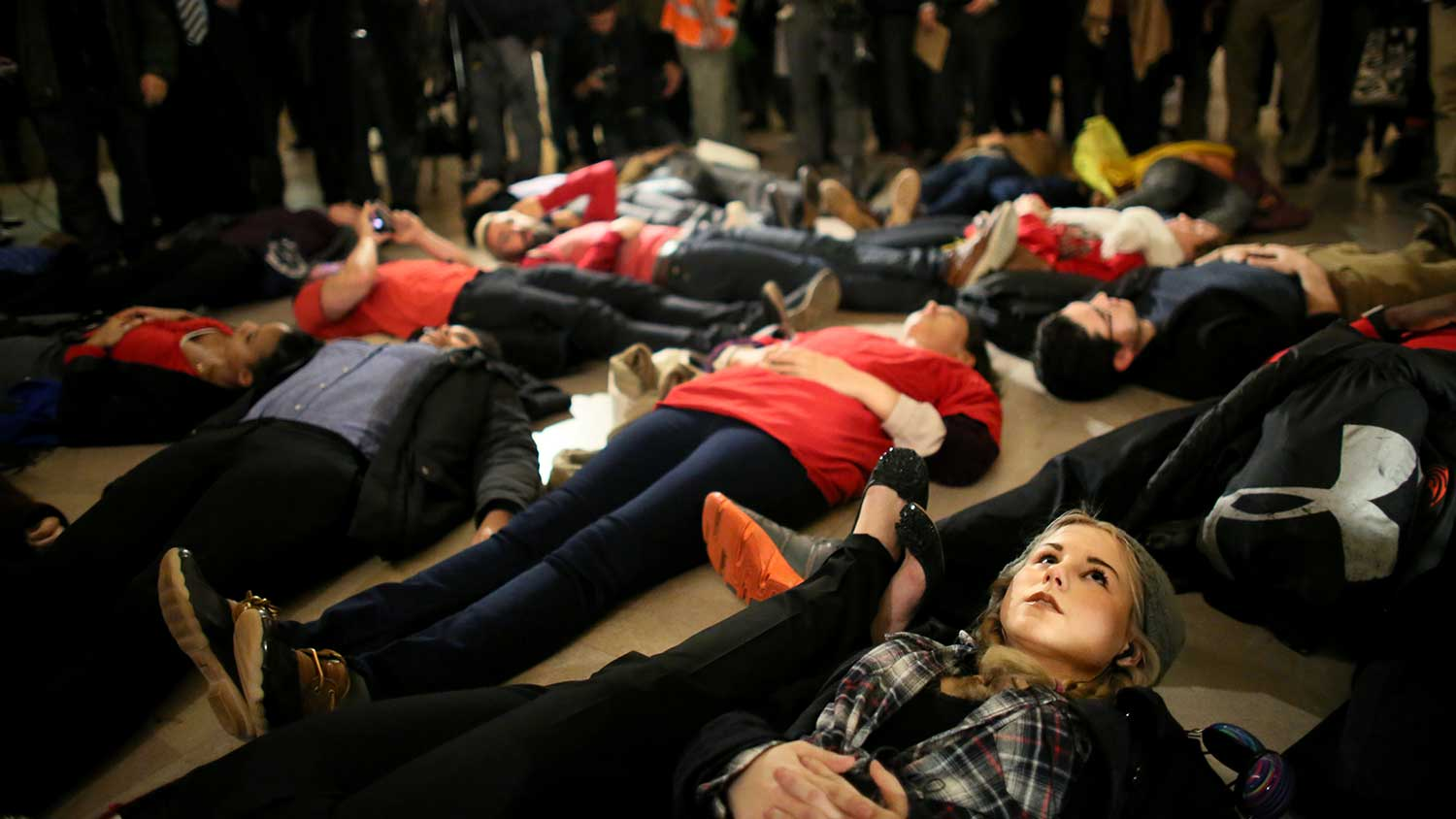Lindsey Ellefson, 22, lies down during a protest in New York's Grand Central Terminal after the grand jury's decision on Dec. 3, 2014.