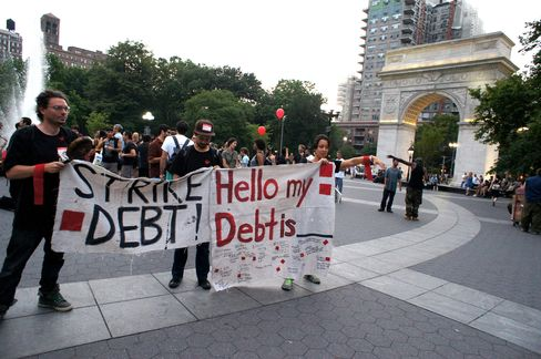 People protest against student debt at Washington Square Park in New York's Greenwich Village
