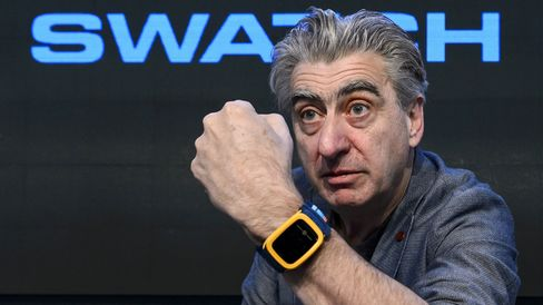 Swatch Group CEO Nick Hayek with the Swatch Touch Zero One wristwatch.