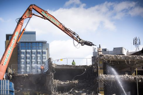 A Bulldozer Works on the site of a Residential Apartment Complex