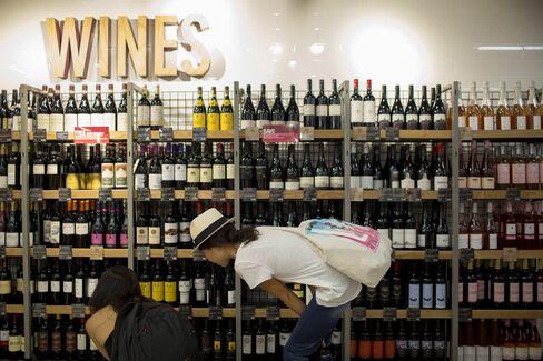 Women Browse Wines in Hong Kong