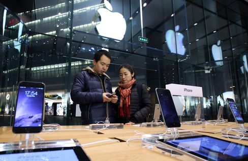 Shoppers Inside An Apple Inc. Store in Beijing