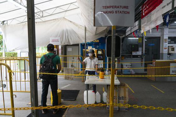 Singapore Keeps Dorm Migrants Segregated Even as CovidAbates