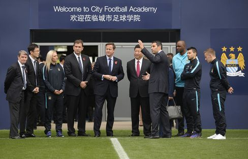 Britain's Prime Minister David Cameron and China's President Xi Jinping with Manchester City chairman Khaldoon Al Mubarak during a visit to the City Football Academy in 2015.