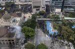 Riot police deploy tear gas in Chater Garden inHong Kong, Jan. 19.