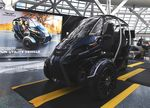 The three-wheeled Arcimoto is one vision of what a car that can't do everything might look like.