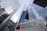The Societe Generale SA logo sits on a sign outside the bank's headquarters in La Defense business district in Paris, France.