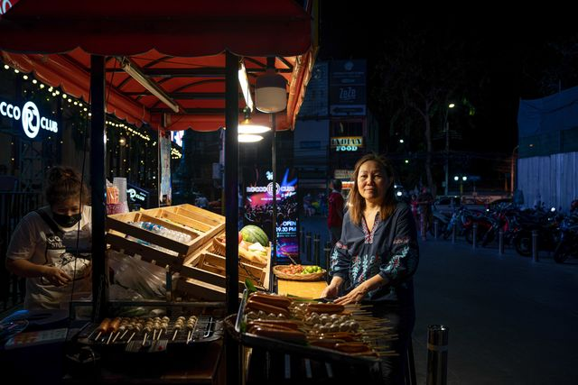 Yada Pornpetrumpa sells street food at her stall on Khaosan Road in Bangkok. Since Covid-19, she figures her daily income has fallen more than 90%.