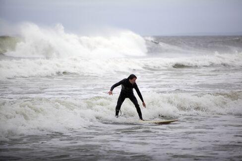 Hurricane Sandy Barrels North, Halts Travel, Forces Evacuations