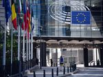 The stars of the European Union (EU) sit on office windows at European Parliament's Paul-Henri Spaak building in Brussels, Belgium, on Wednesday, May 27, 2020.