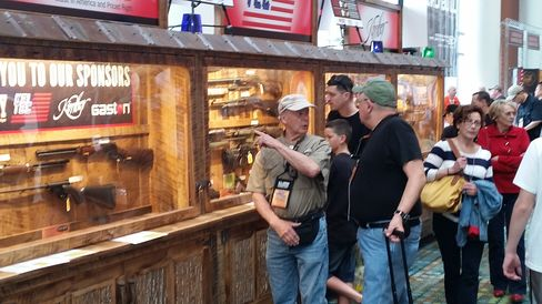 NRA convention attendees review guns being raffled off in Nashville.