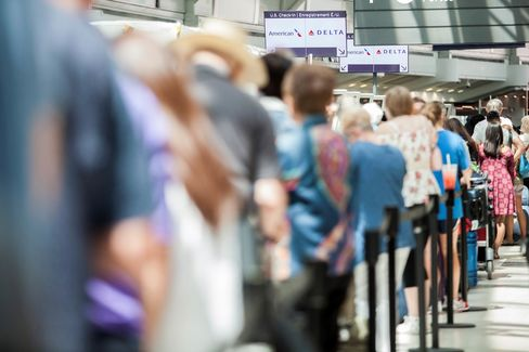 Passengers await updates from Delta at Pearson International Airport in Toronto, on Aug. 8.
