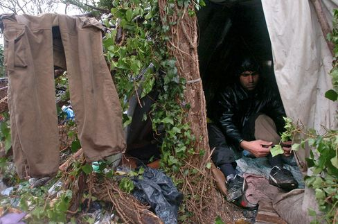 "An illegal immigrant is seen at a camp called ""the jungle"" in Calais, France, Wednesday, January 10, 2007"