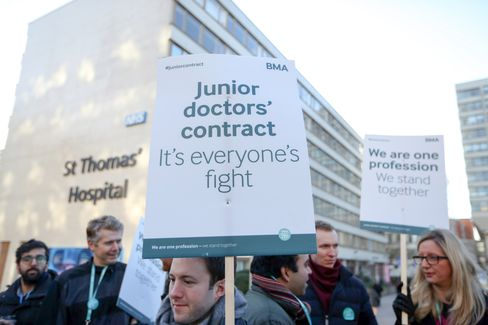 Junior doctors hold placards outside St Thomas' Hospital in London.