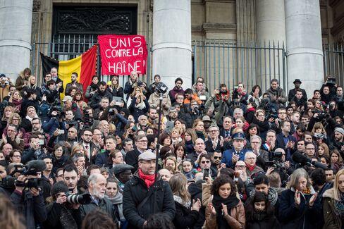 People gather at the Place de la Bourse.