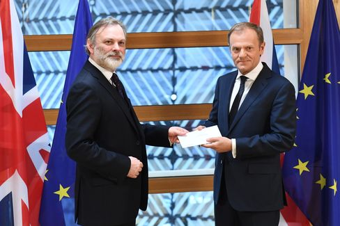 U.K. ambassador to the EU Tim Barrow delivers Theresa May's letter to Donald Tusk in Brussels, March 29.
